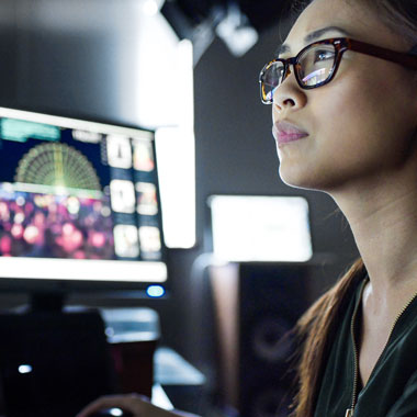 Forensic woman at computer screen