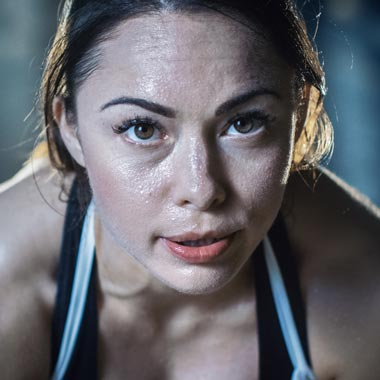 Female athlete close up looking at camera after workout