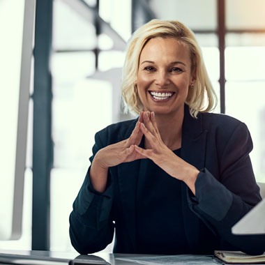 Woman at desk smiling