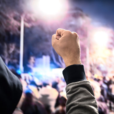 Protest man with fist raised